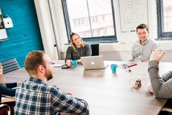 impression digital marketing team meeting